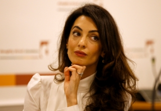Lawyer Amal Clooney listens during a news conference for Mohamed Nasheed in central London